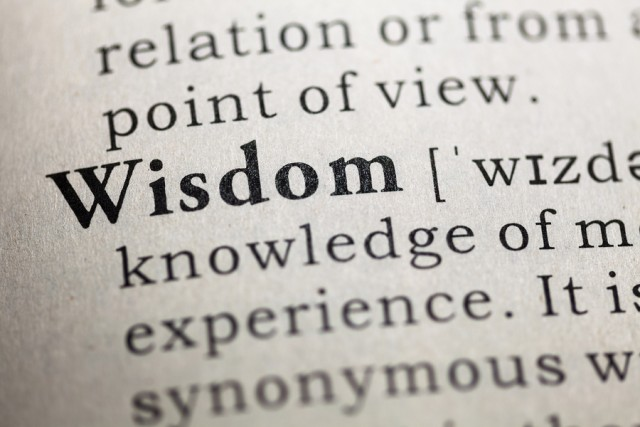 Dictionary definition of the word Wisdom. close up