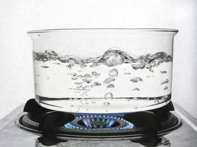 Water boiling in glass pan